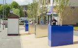 Tree planters in Ultramarine Blue are paired with stainless steel in this high street project for Clackmannanshire council