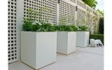 Squares powder coated in RAL 9010 (Pure White). The design incorporates small plinths to create a 'shadow gap'.