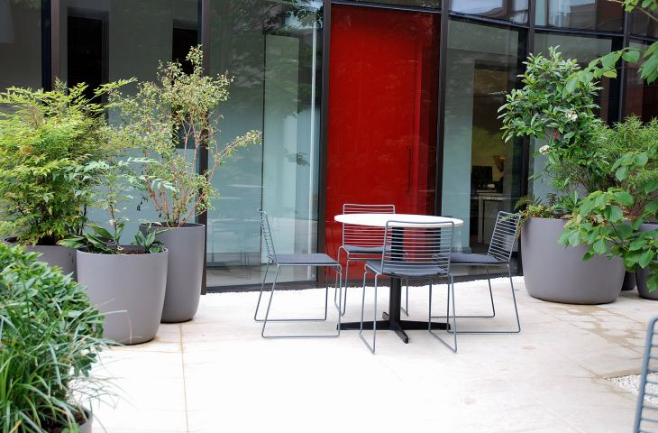 Boulevard planters green the strikingly modern courtyard