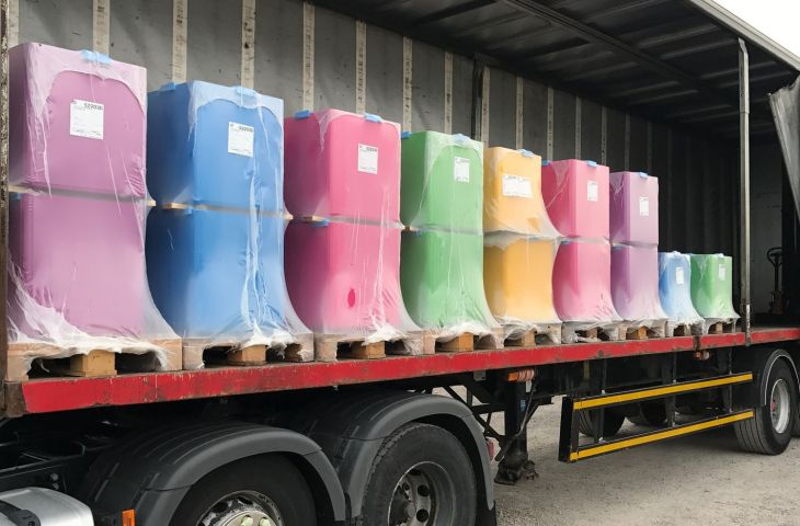 brightly coloured planters for a school