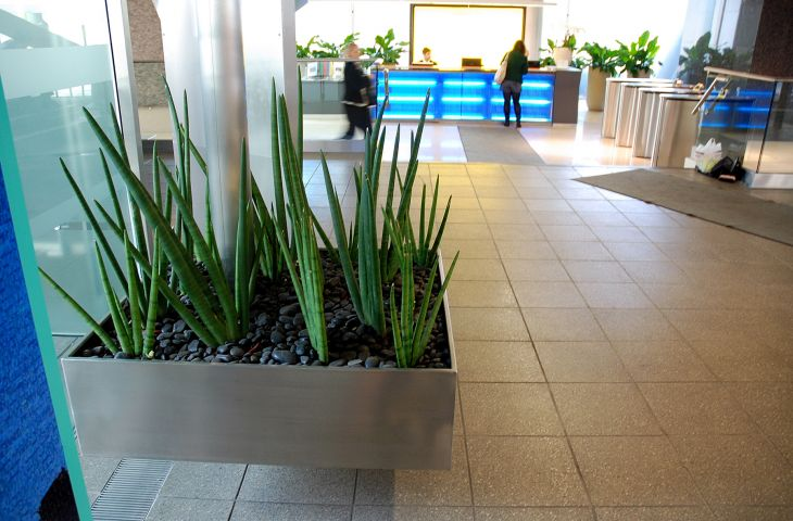 Suspended stainless steel planter at Centre Point, London