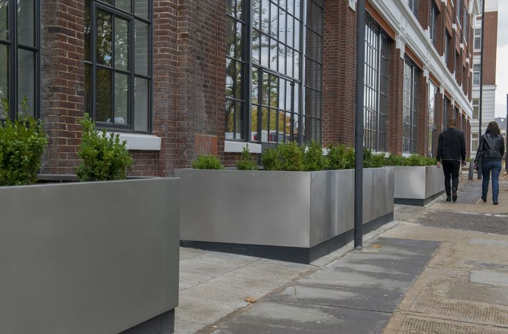 Bespoke stainless steel street planters at 184 Shepherds Bush Road