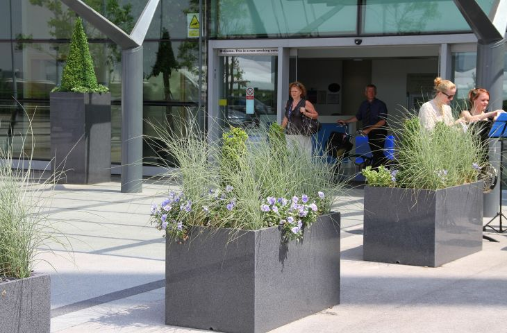 1300mm trough planters create a strong visual line leading to the entrance doors of The City of Manchester Stadium