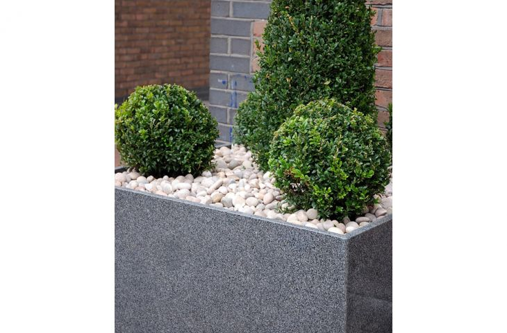 Bespoke granite planters for Plantation Wharf, Battersea