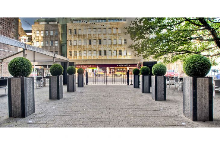 1000mm tall bespoke granite column planters in Stratos design