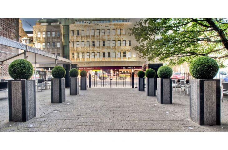 1000mm tall bespoke granite column planters in Stratos design