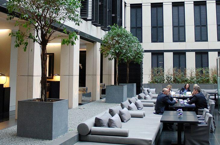 Bespoke IOTA granite tree planters at Grosvenor House Apartments