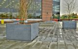 Bespoke granite benches and tree planters in honed finish