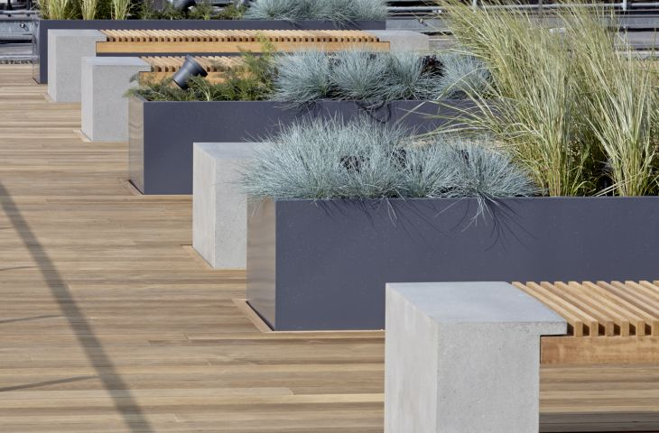 Steel trough planters alternate with benches