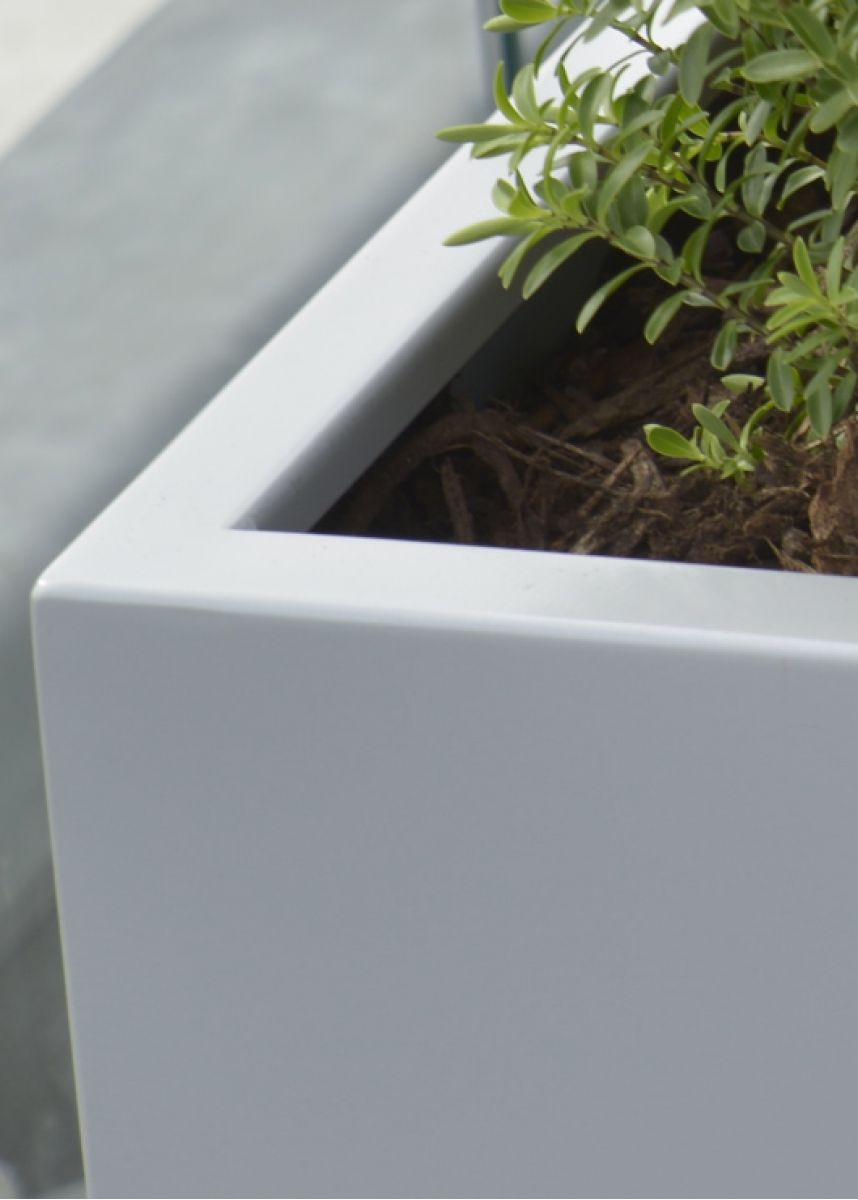 Corner close up white planter pot