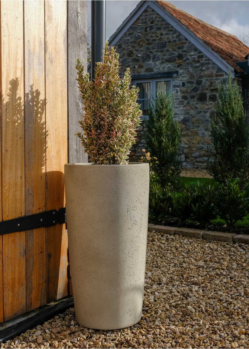 Tall round stone coloured planter