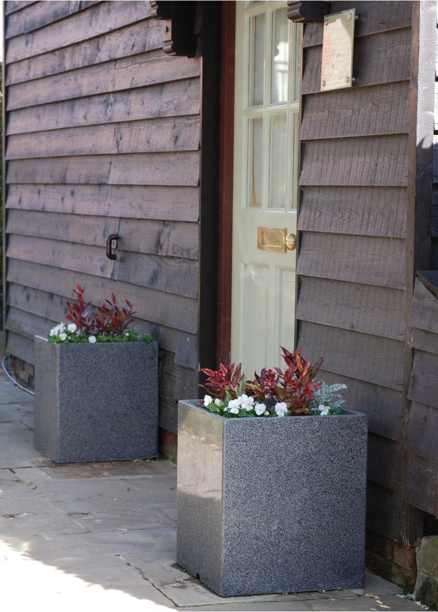 Square granite plant pots in entranceway