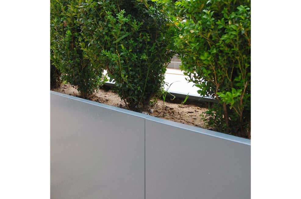 Visually seamless planting for office development public planters