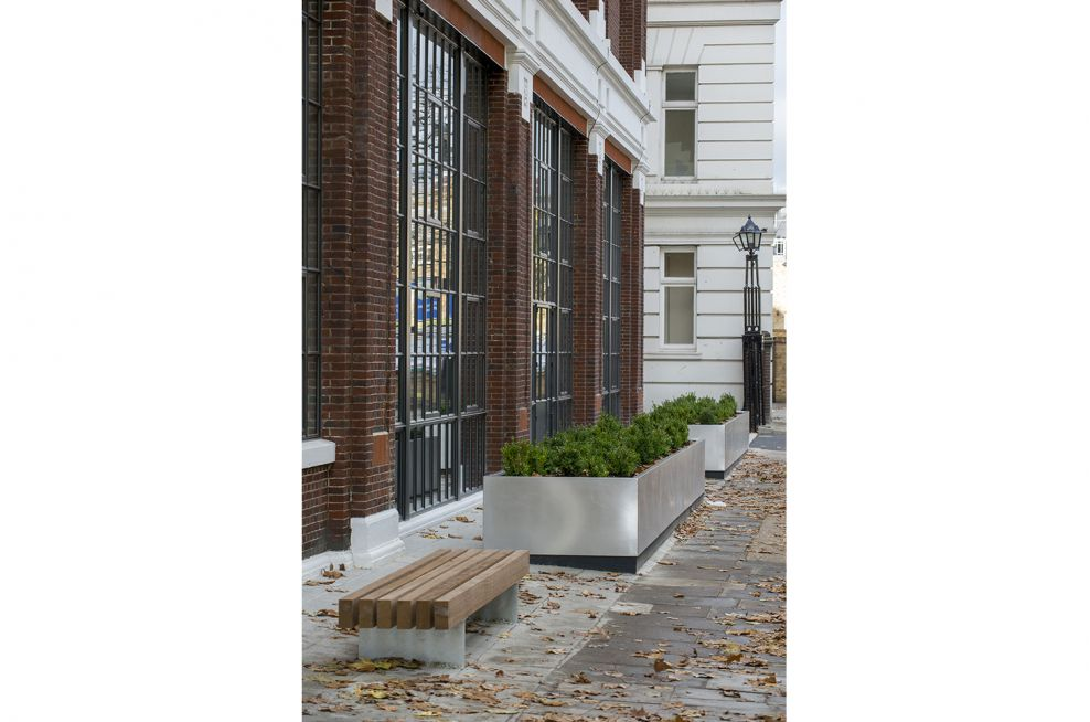 Trough style public planter with brushed stainless steel finish