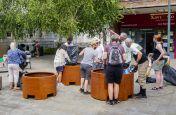 Volunteers filling public planters