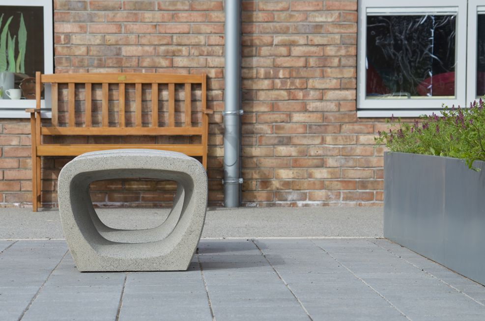 Courtyard seating alongside the steel extra large planters