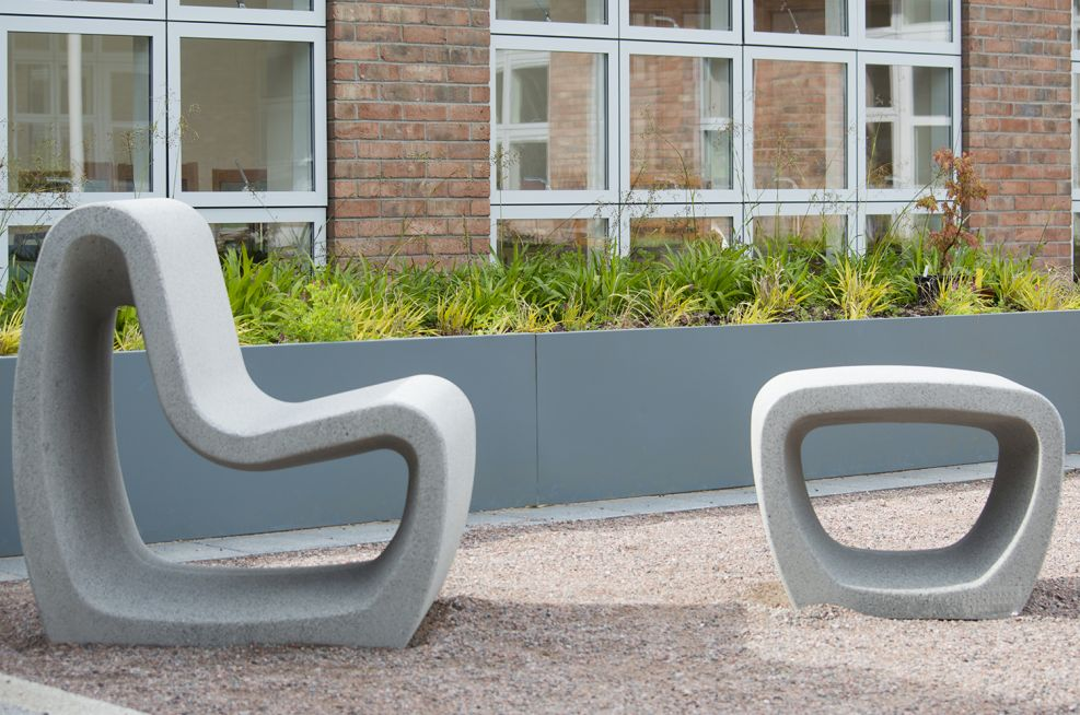 Outside courtyard with garden furniture and blue grey planter