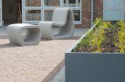 Powder coated steel planter with designer garden furniture