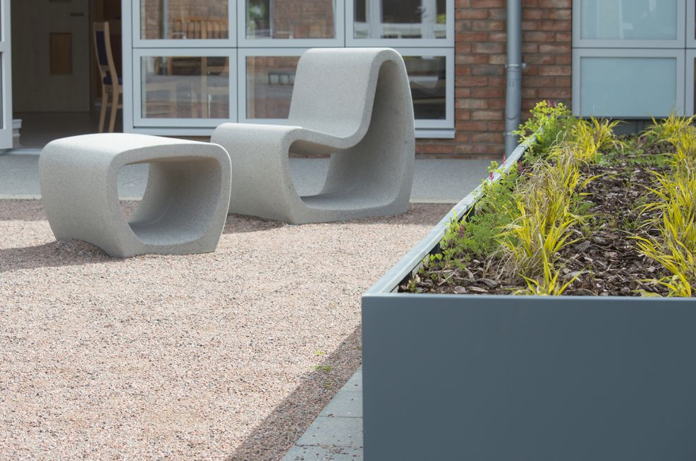Powder coated steel planter with designer garden furniture