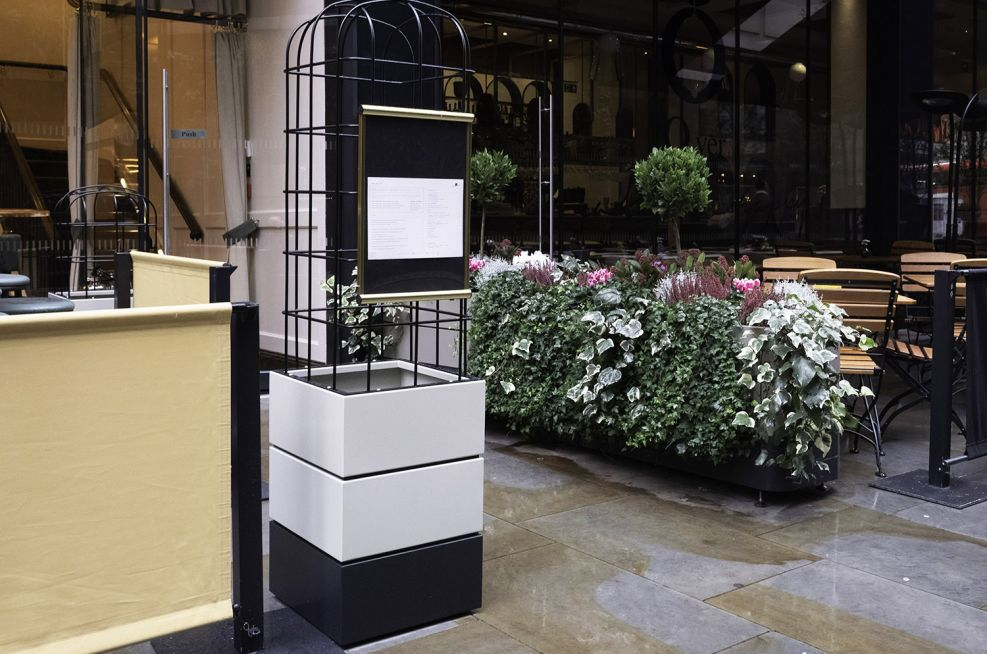 Planters with restaurant menu board attached