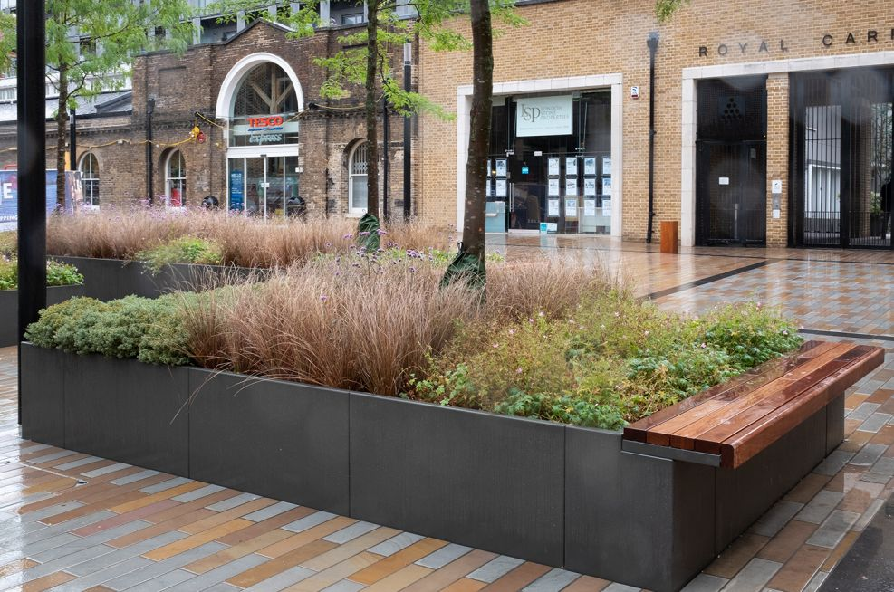 Open bottom planters with bench seating