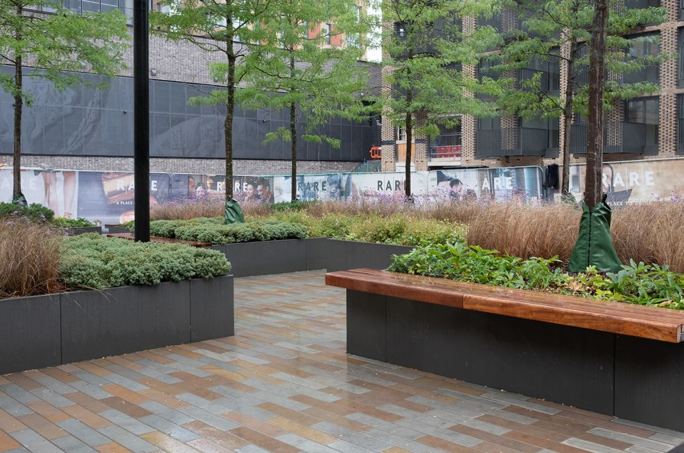 sectional tree planters with integrated seating