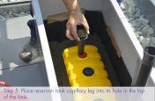 Placing reservoir tank capillary legs into the reservoir