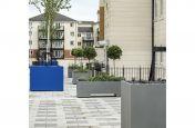 Steel planters for communal podium decks