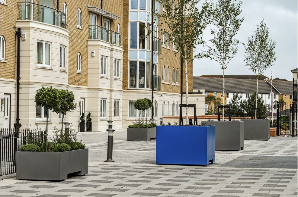 Steel planters for communal podium decks