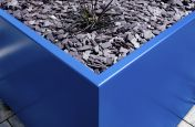 Coloured metal plant containers