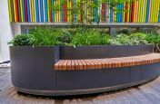 Planter with inset wooden bench seating