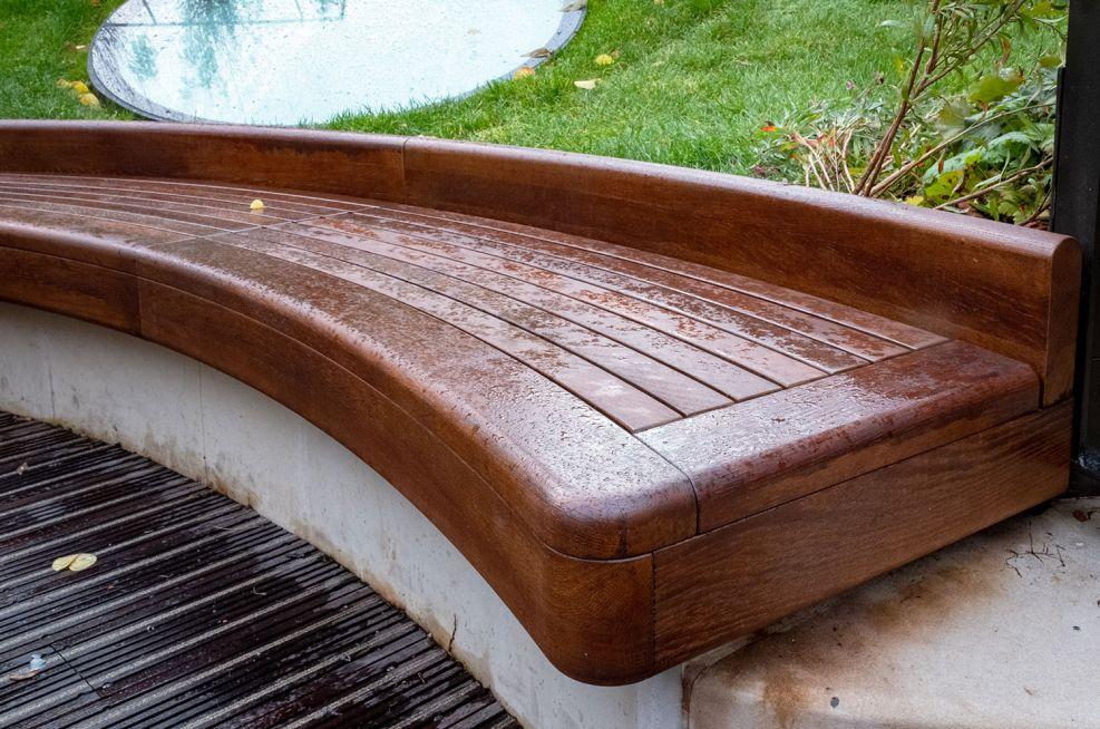 Hardwood slatted curved bench