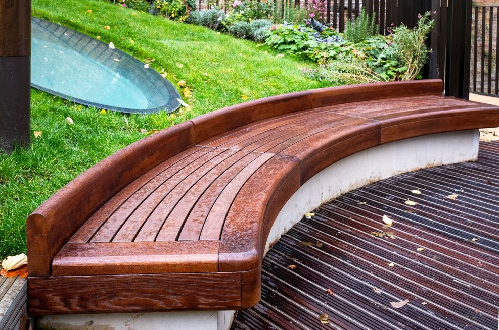 Curved timber garden bench