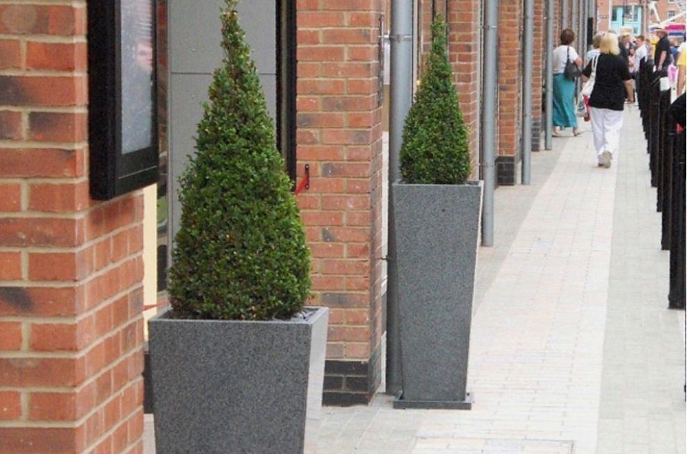 IOTA Tall Taper Granite planters at Gloucester Quays Designer Outlet Shopping Mall.