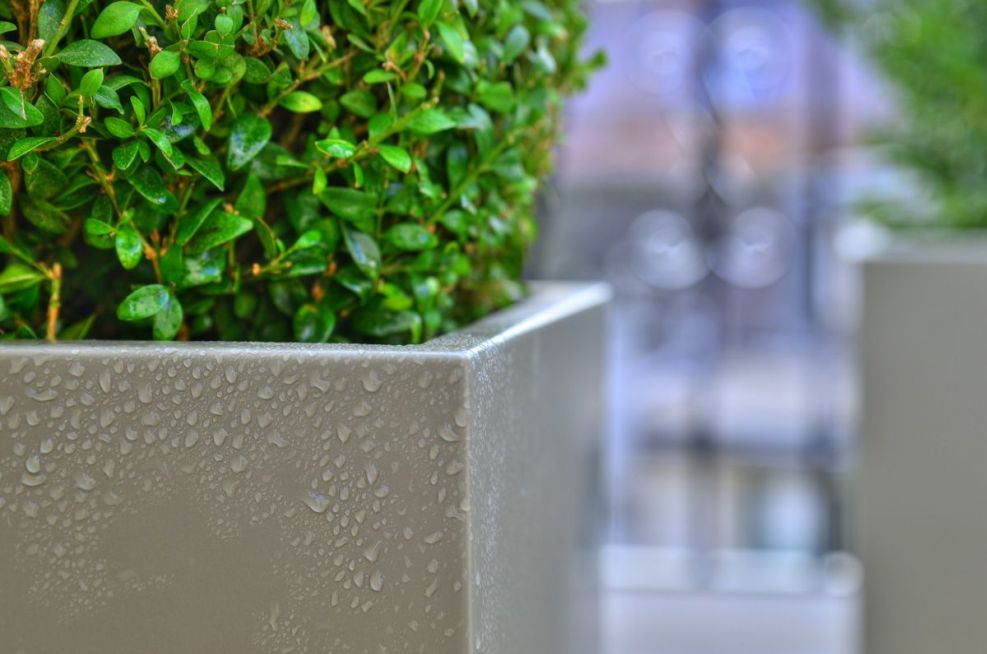 Powder Coated Steel Planters in Pearl Mouse Grey On Garden Terrace