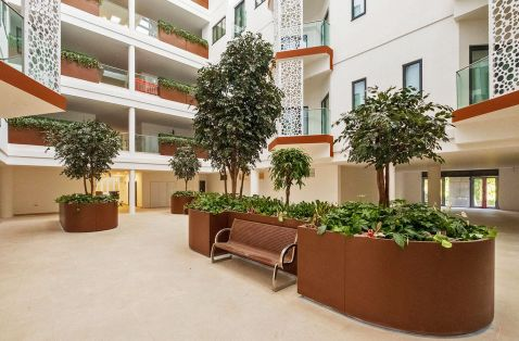 Large bespoke steel planters for atrium