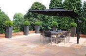 Tall Taper Extra Large Granite Planter On Outdoor Dining Terrace
