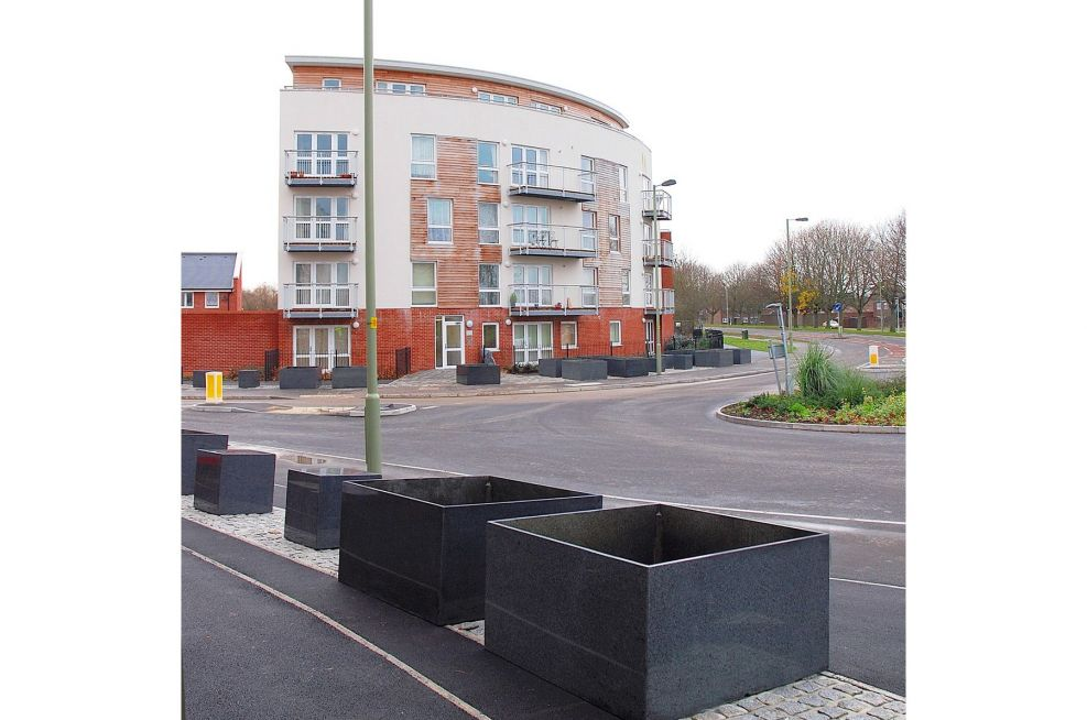 IOTA Granite Planters Installed On The Pavement