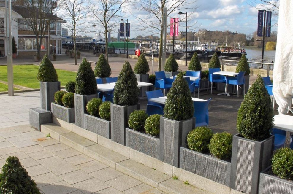 Granite Planters Decorating The Eating Area