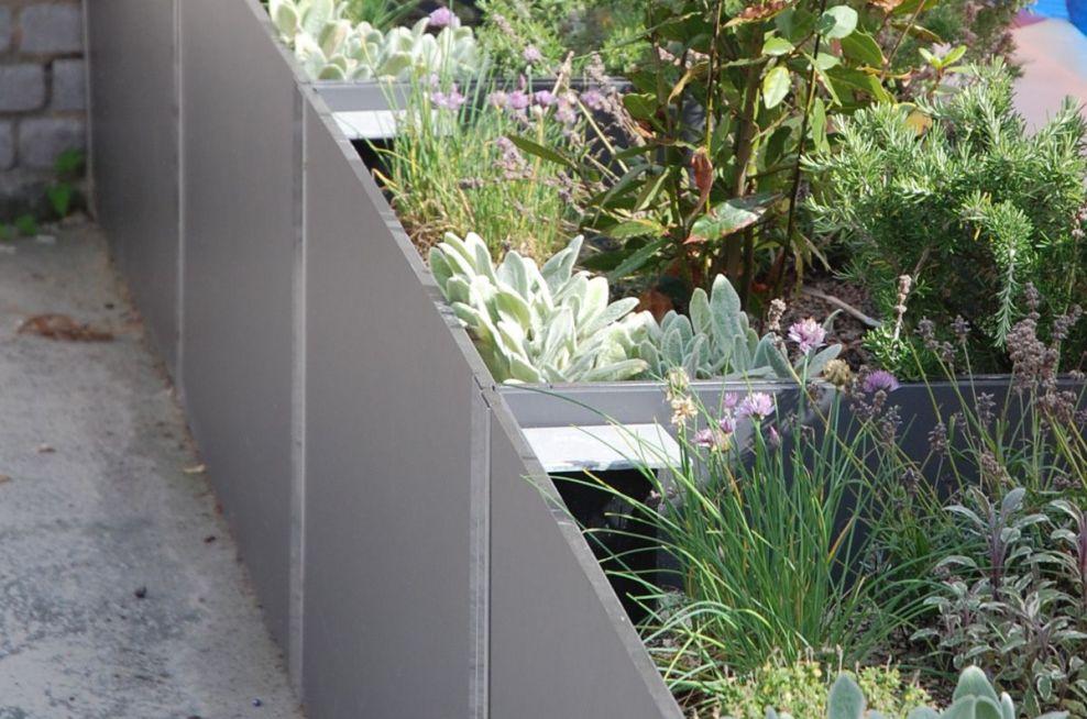 Delta Carat planters At The Malborough Sports Garden