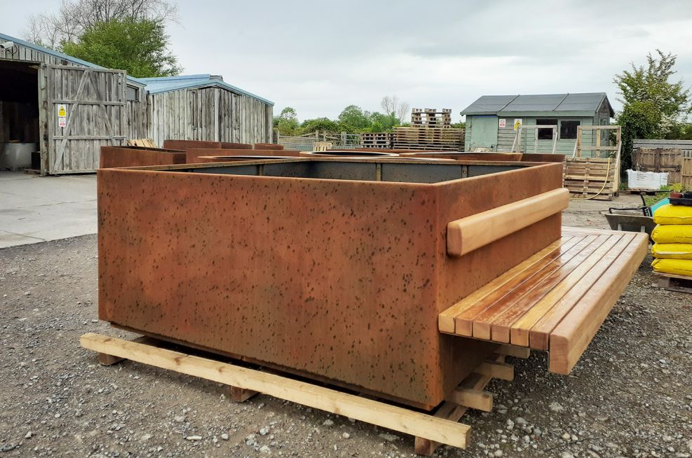 Corten planter integrated bench seating