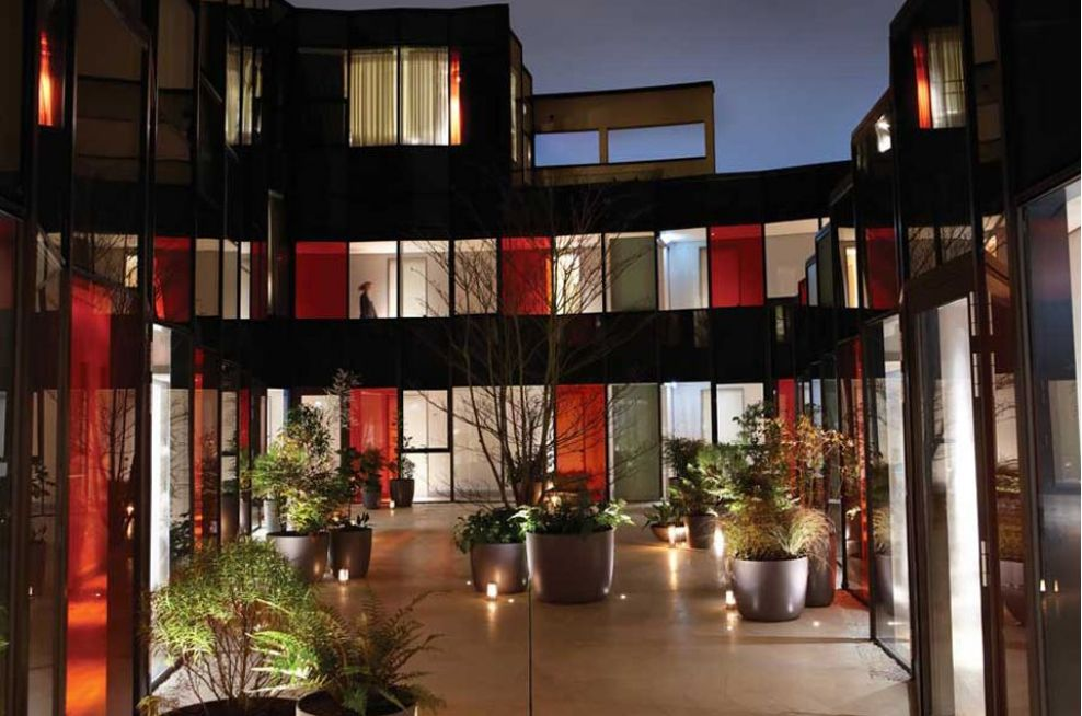 Montpellier Chapter Courtyard At Night With Boulevard Planters