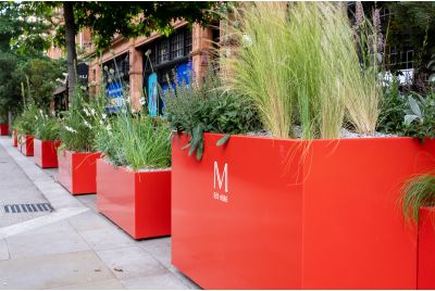 coral red street planters in Mayfair