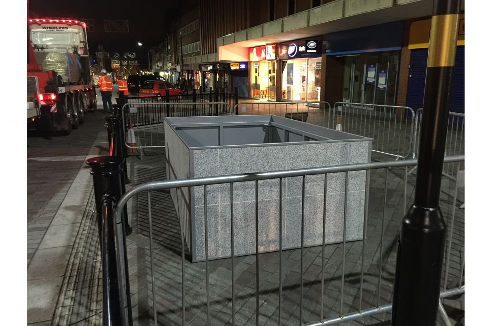 Granite And Steel Planters Lifted Into Place