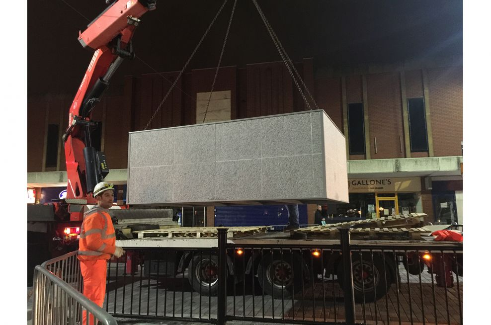 Large Granite Planters Being Lifted Into Place