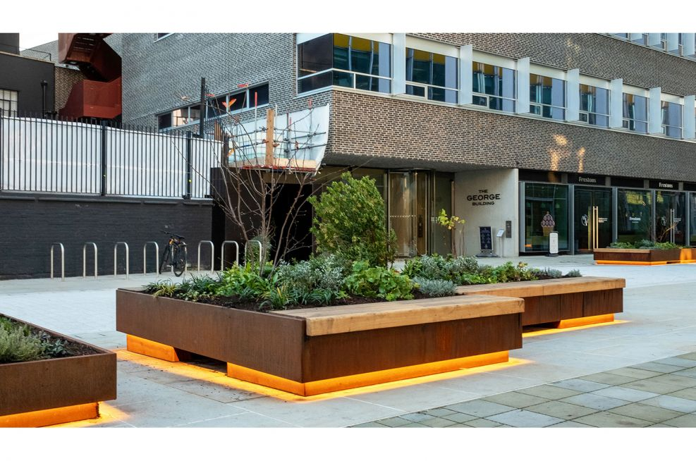 Large planters and bench seating