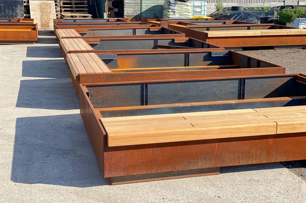 Bench seating weathered corten planter