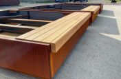 Timber bench for metal landscaping planters