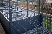 Planters with integrated security fencing