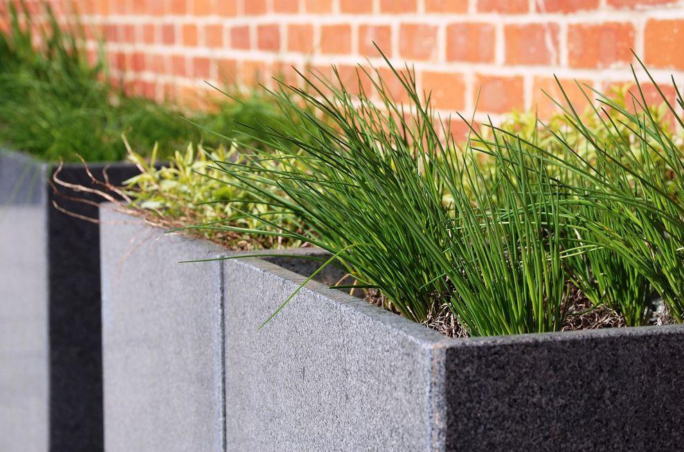 A Row Of Trough 1000 Granite Planters